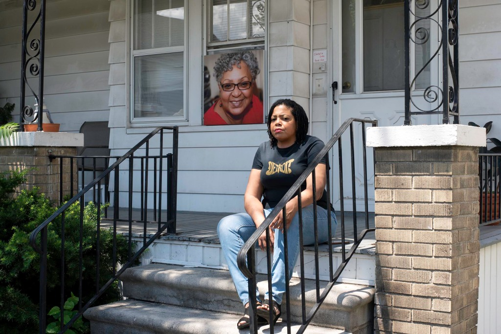 Biba Adams sits on the porch at her home with a picture of her mother who succumbed to COVID-19 in Hamtramck, MI on Friday, June 19, 2020.