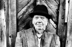 Watch Neil Young Play Two Acoustic Songs Near a Fireplace