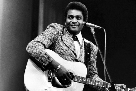 Charley Pride performs on a TV show, London, February 1975. (Photo by Michael Putland/Getty Images)