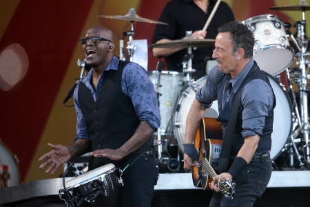 Bruce Springsteen performs with percussionist Everett Bradley and drummer Max Weinstein, above, at the New Orleans Jazz and Heritage Festival in New Orleans, Saturday, May 3, 2014. (AP Photo/Gerald Herbert)