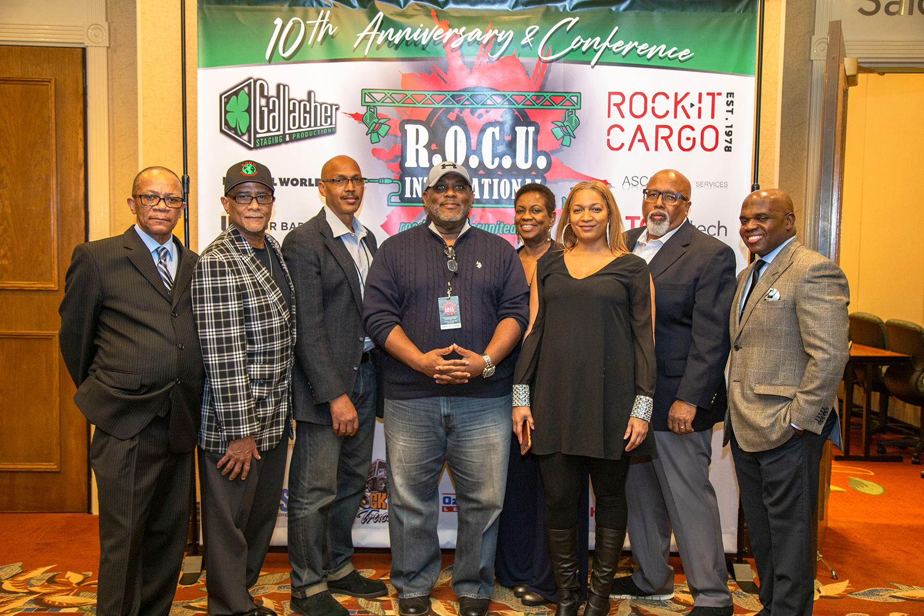 """KC Jackson, Stuart Gray, Victor Reed Sr., David """"5-1"""" Norman, Lisa Pittman Dennis, Shae Usher, Bill Reeves, and Ronnie Stephenson of the Roadies Of Color United 10th Anniversary Planning Committee"""