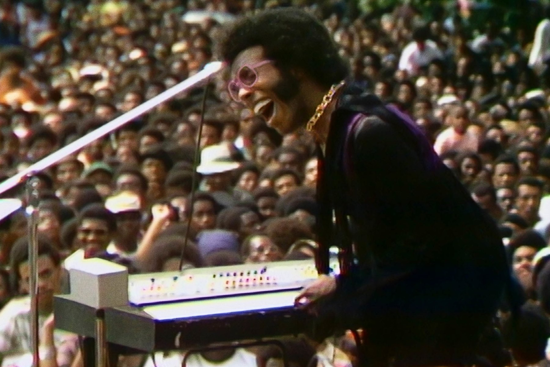 Sly Stone of Sly and the Family Stone, giving the crowd what they want, in a scene from the documentary 'Summer of Soul.'