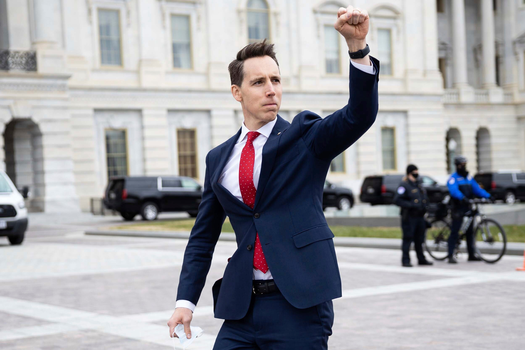 Sen. Josh Hawley (R-Mo.) gestures toward a crowd of supporters of President Donald Trump gathered outside the U.S. Capitol to protest the certification of President-elect Joe Biden's electoral college victory Jan. 6, 2021 at the US Capitol in Washington, DC. Some demonstrators later breached security and stormed the Capitol. (Francis Chung/E&E News and Politico via AP Images)