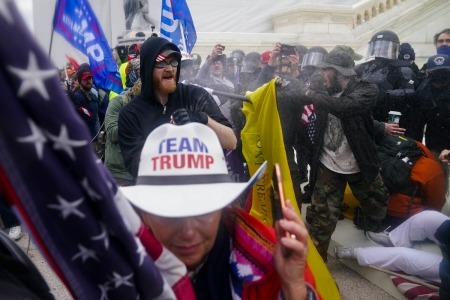 FILE - In this Jan. 6, 2021, file photo, Trump supporters try to break through a police barrier at the Capitol in Washington. The U.S. registered its highest deaths yet from the coronavirus on the same day as a mob attack on the nation's capitol laid bare some of the same, deep political divisions that have hampered the battle against the pandemic. (AP Photo/John Minchillo, File)