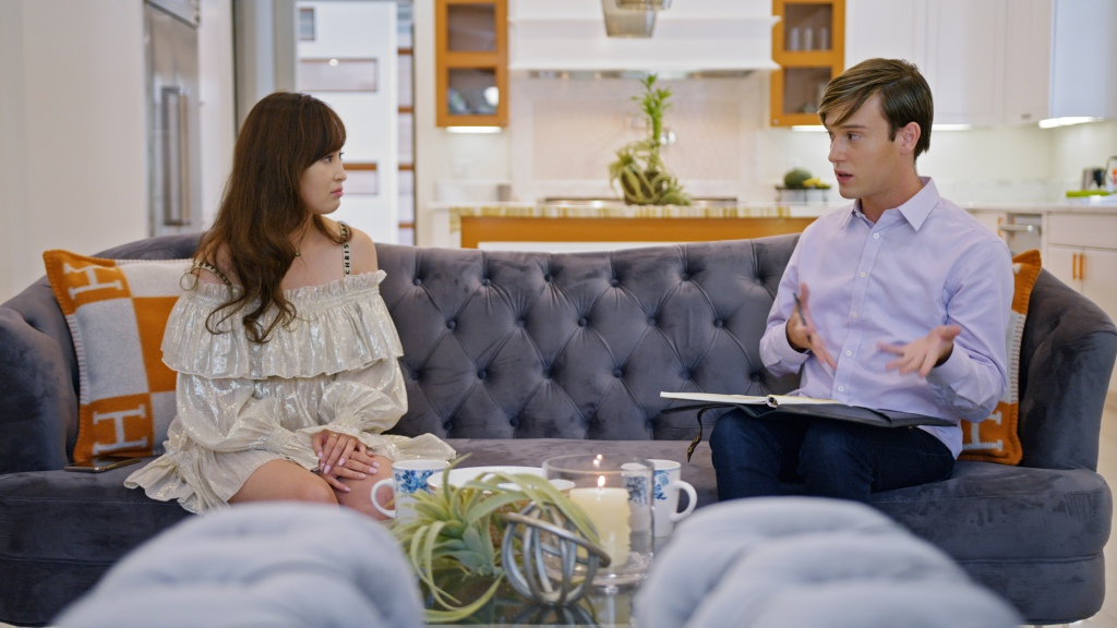 """(L-R) Cherie with Tyler Henry (Hollywood Medium) in episode 6 """"The Other Side"""" of Bling Empire: Season 1. c. Courtesy of Netflix © 2021"""