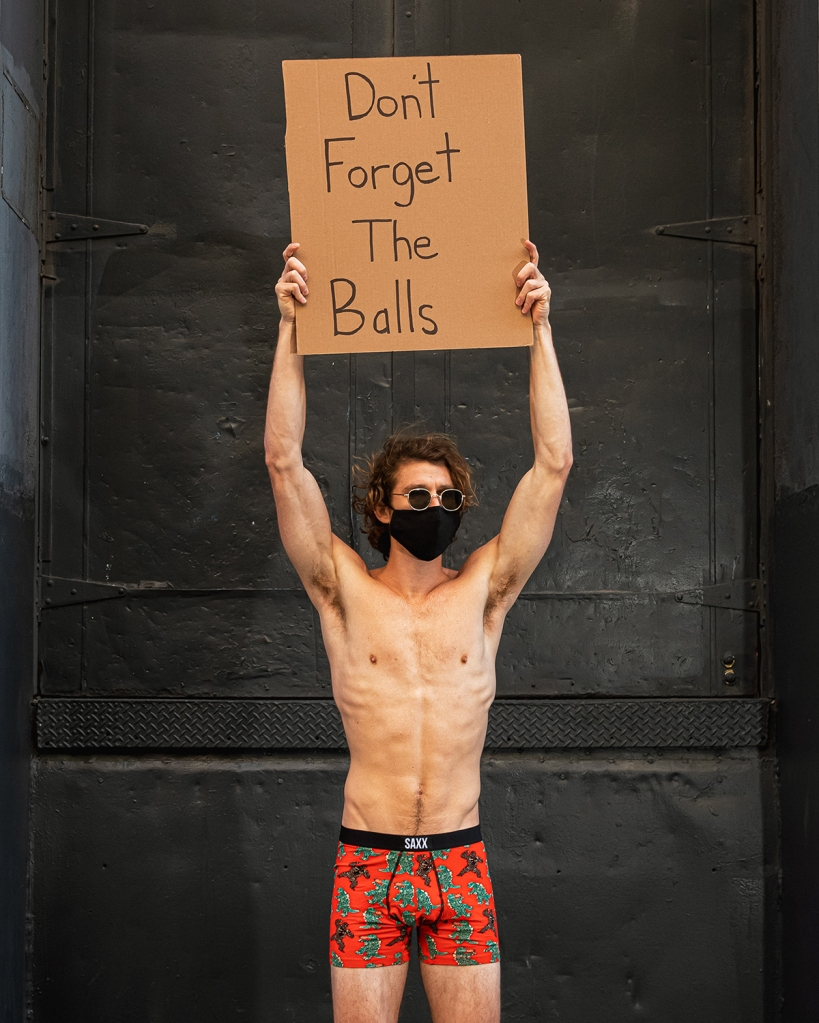 dude with sign underwear