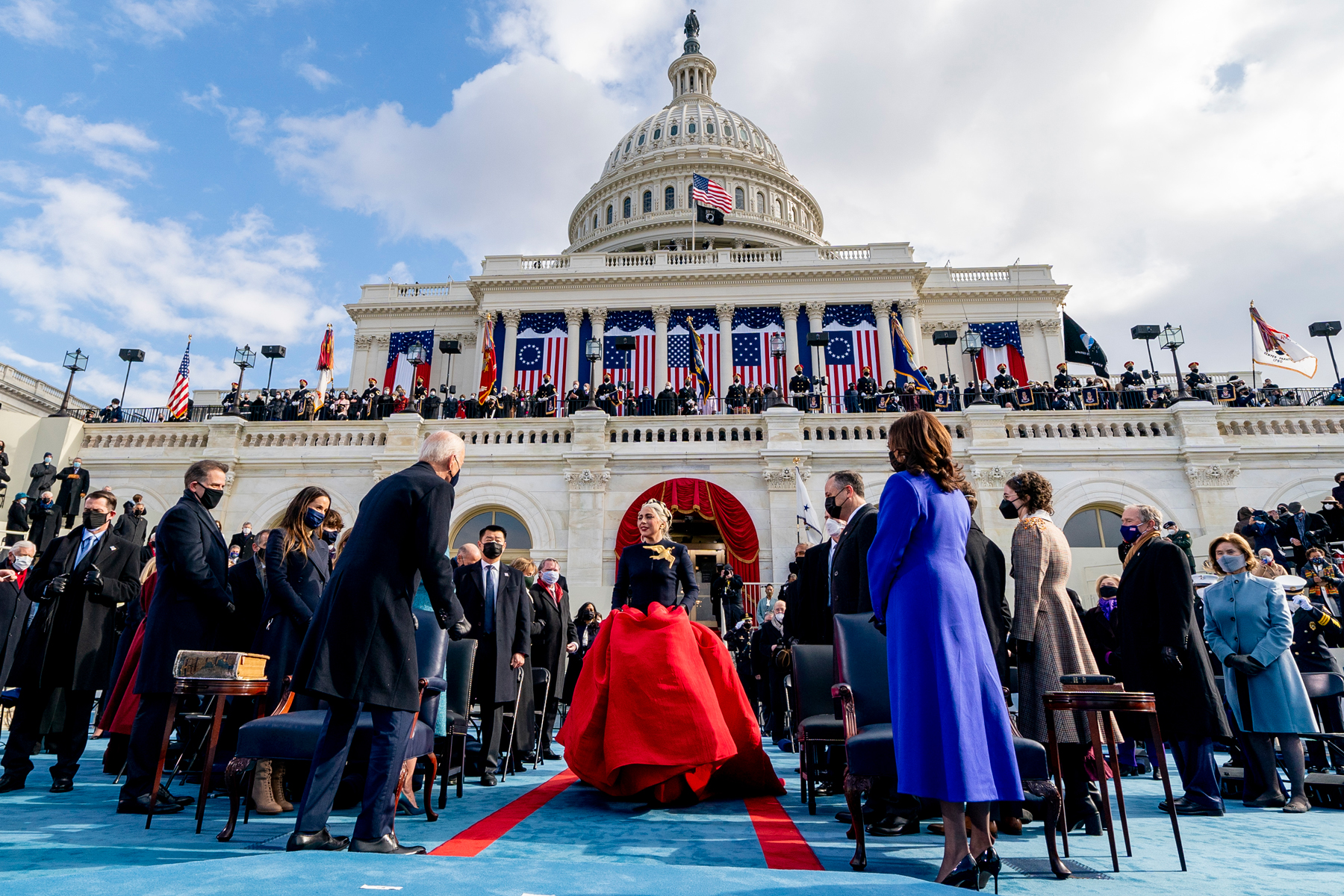 US singer Lady Gaga (C) arrives to perform the National Anthem as President-elect Joe Biden (L) and Vice President-elect Kamala Harris (R) watch during the 59th Presidential Inauguration on January 20, 2021, at the US Capitol in Washington, DC. (Photo by Andrew Harnik / POOL / AFP) (Photo by ANDREW HARNIK/POOL/AFP via Getty Images)