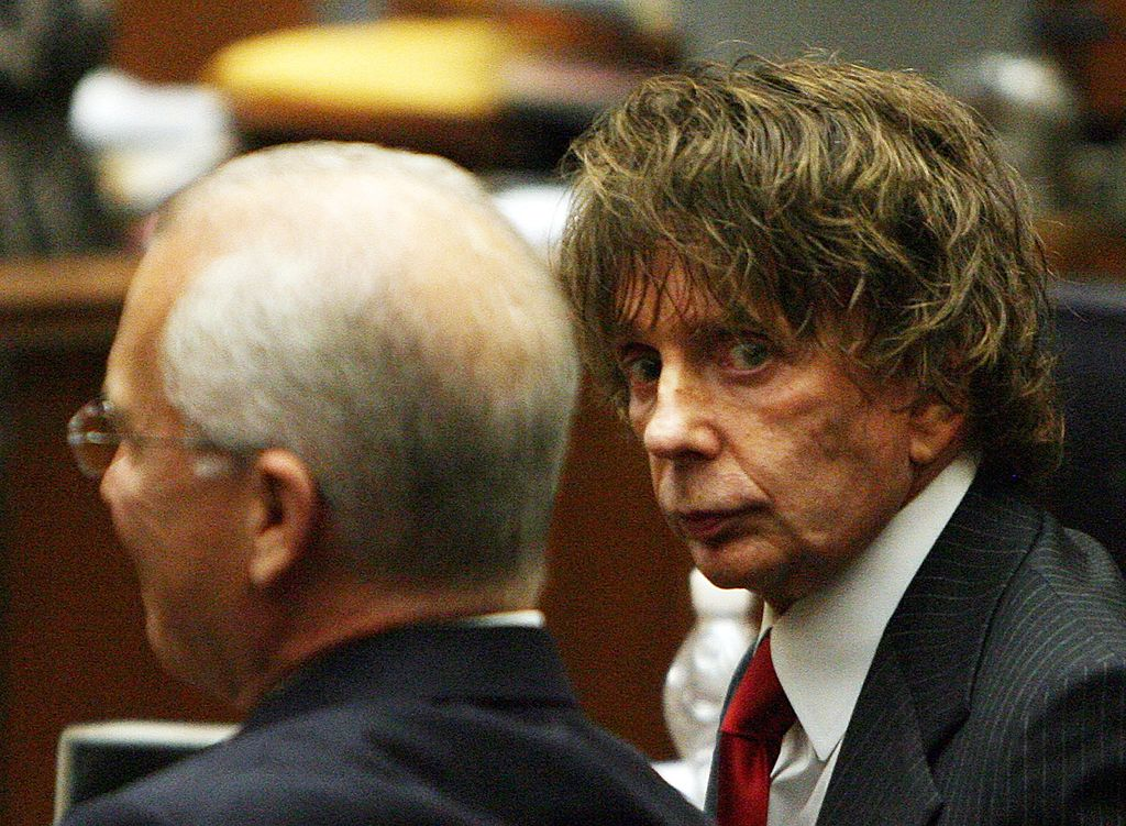 LOS ANGELES - SEPTEMBER 18: Music producer Phil Spector (R) sits with his attorney Roger Rosen (L) during his murder trial September 18, 2007 in Los Angeles, California. Spector, 67, is accused of fatally shooting 40-year-old Lana Clarkson in February 2003. The murder case went to the jury September 10. Today the jury announced they have not reach a verdict while Judge Larry Paul Fidler ordered the jury to come back tomorrow for additional instructions and to continue deliberating on the case. (Photo by Gabriel Bouys-Pool/Getty Images)