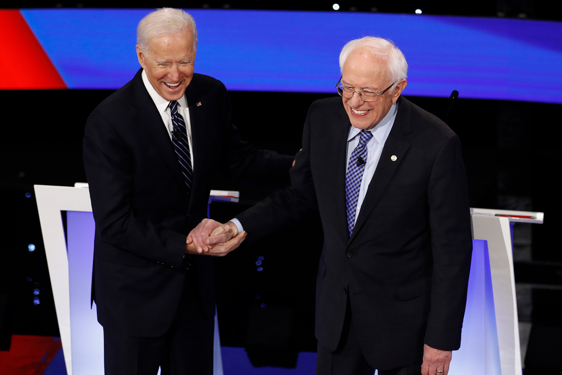Democratic presidential candidates former Vice President Joe Biden, left, and Sen. Bernie Sanders, I-Vt., greet each other Tuesday, Jan. 14, 2020, before a Democratic presidential primary debate hosted by CNN and the Des Moines Register in Des Moines, Iowa. (AP Photo/Patrick Semansky)