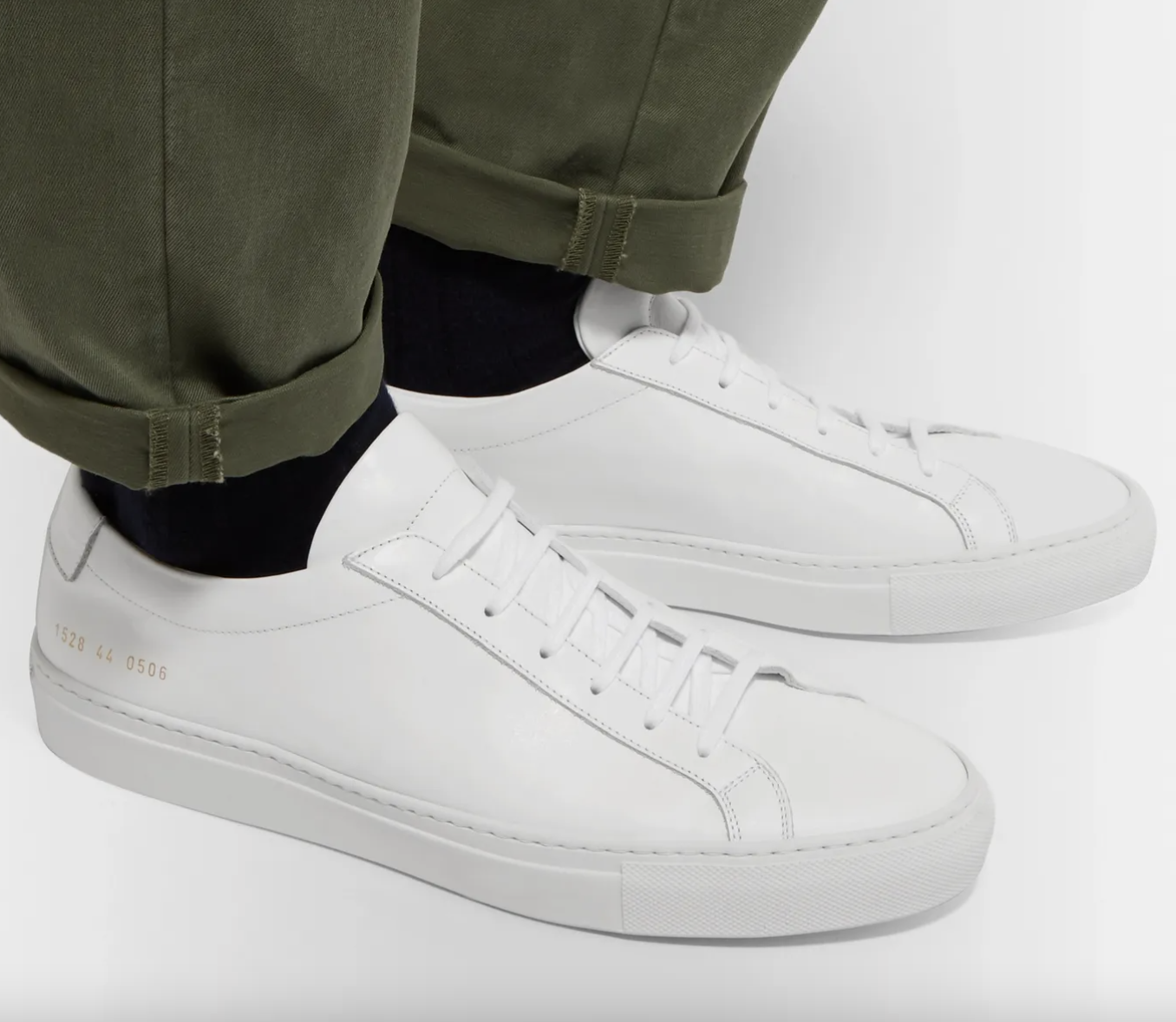 white sneakers common projects