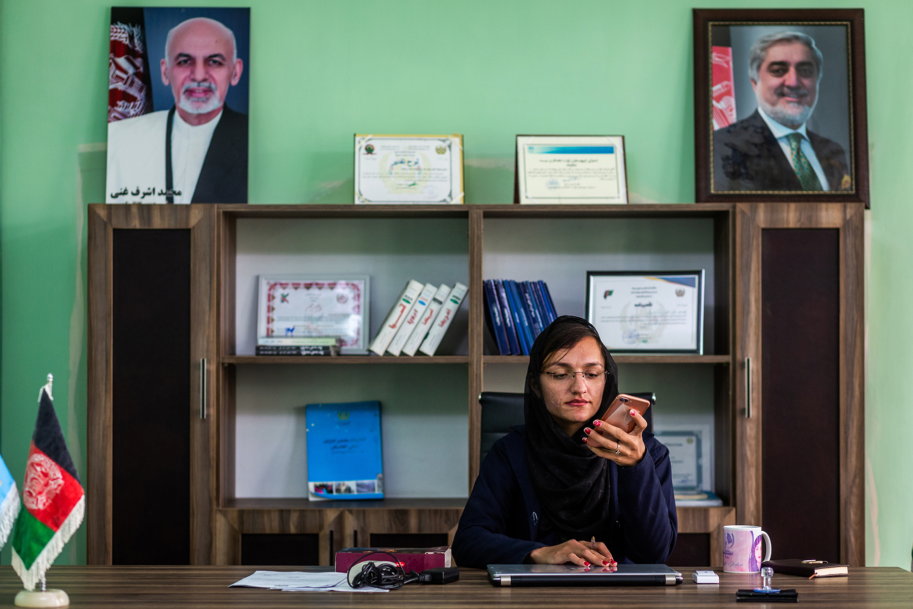 "Zarifa Ghafari, mayor of Maidan Shar, Afghanistan, works in her office, April 7, 2019. ""My job is to make people believe in women's rights and women's power,"" she has said. The town is in the particularly conservative province of Wardak, where support for the Taliban is widespread. (Jim Huylebroek/The New York Times)"
