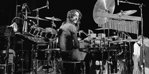 CLEVELAND, USA - 17th DECEMBER: Drummer Neil Peart from Canadian progressive rock band Rush posed at his drum kit in the Public Auditorium in Cleveland, Ohio on 17th December 1977. (Photo by Fin Costello/Redferns)