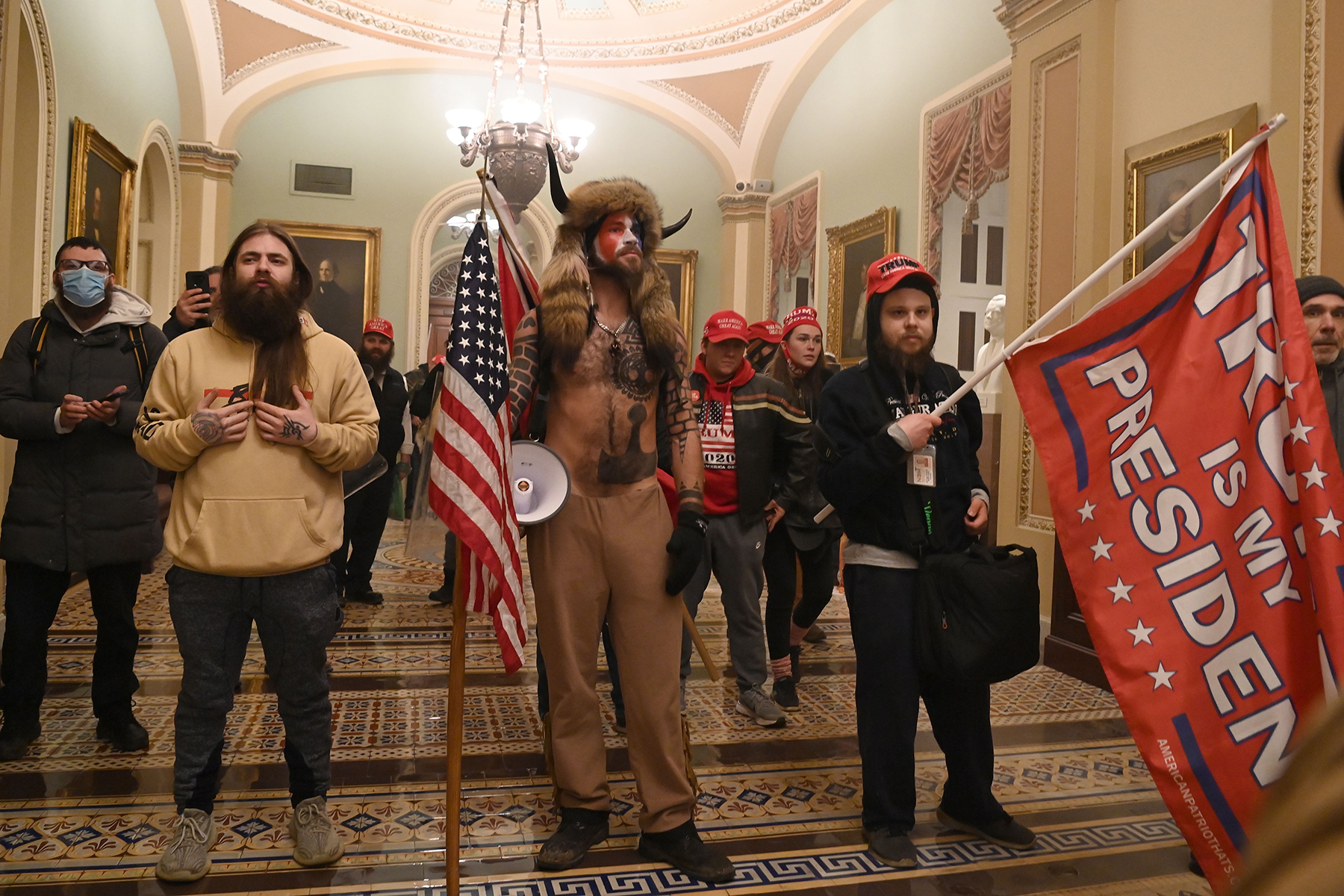 TOPSHOT - Supporters of US President Donald Trump enter the US Capitol on January 6, 2021, in Washington, DC. - Demonstrators breeched security and entered the Capitol as Congress debated the a 2020 presidential election Electoral Vote Certification. (Photo by Saul LOEB / AFP) (Photo by SAUL LOEB/AFP via Getty Images)
