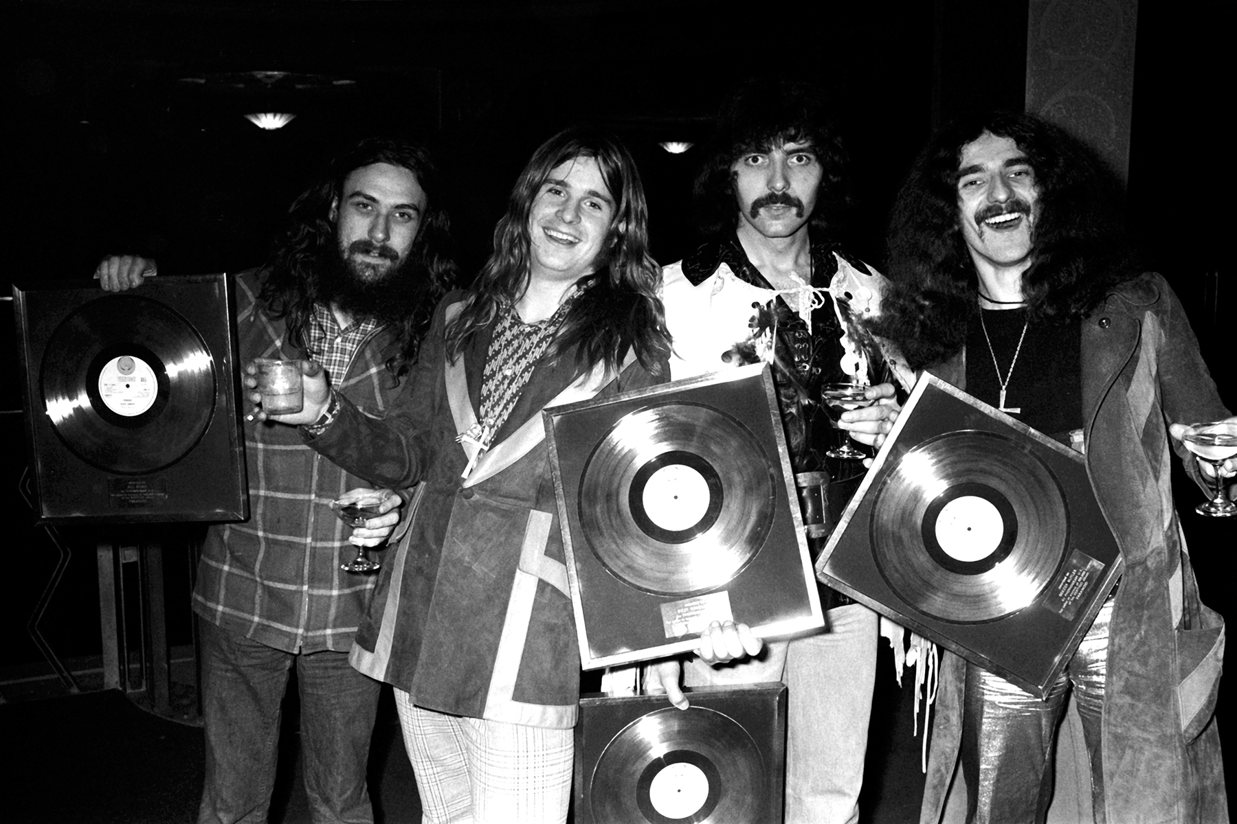 Bill Ward, Ozzy Osbourne, Tony Iomma and Geezer Butler of Black Sabbath photographed with gold discs in 1973.© Michael Putland / Retna UK. Credit all uses