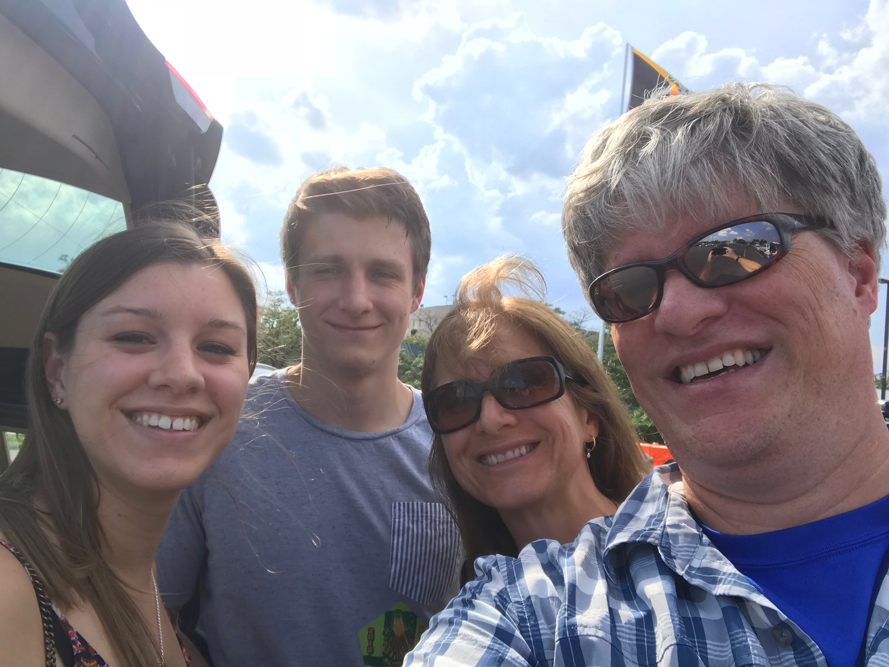Tom with his family, from left, Anna, Brodie and Lea-Lea, in the parking lot before a 2018 Phish show in Camden, NJ.