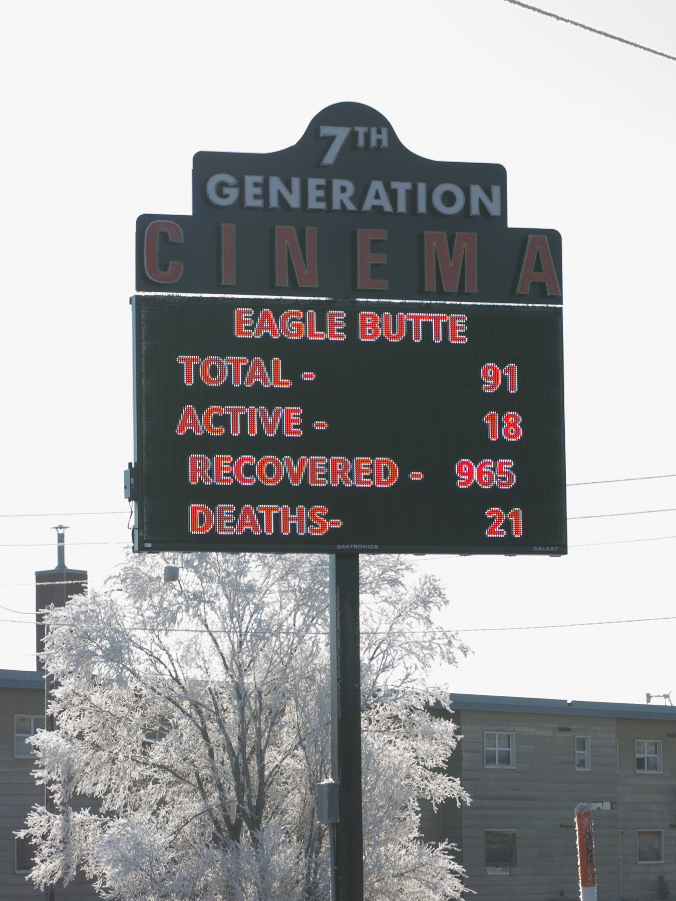 """A list of the daily Covid-19 cases on 7th Generation Cinema signage on the Cheyenne River Sioux reservation in Eagle Butte, South Dakota, U.S., on Saturday, Jan. 30, 2021. Covid is on the retreat in South Dakota, not long ago the virus's epicenter in the U.S. """"We were in dire straits,"""" said Harold Frazier, chairman of the Cheyenne River Sioux, who set up highway checkpoints and instituted lockdowns to protect a community whose health was already challenged by poverty, obesity and diabetes. Photographer: Dawnee Lebeau/Bloomberg via Getty Images"""