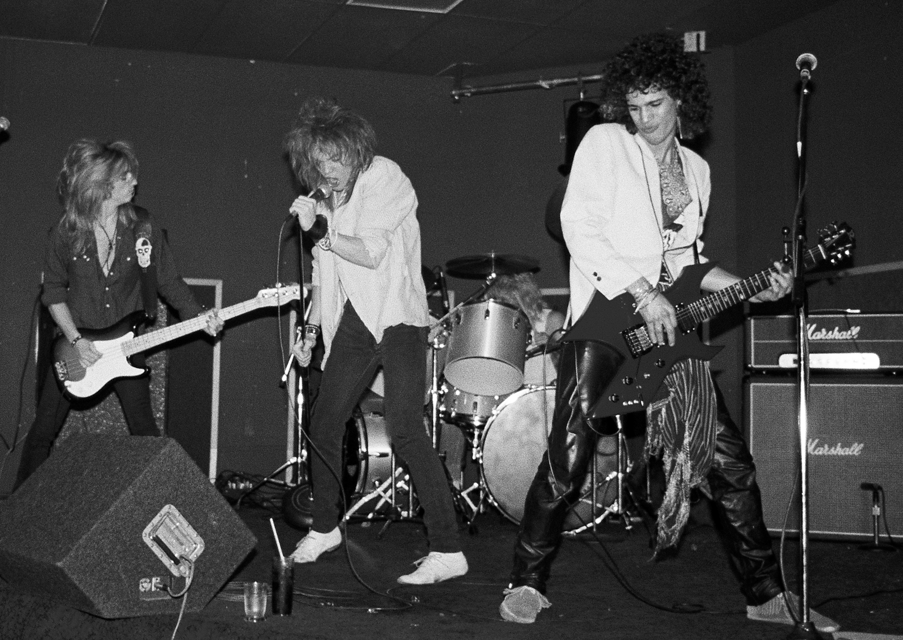 LOS ANGELES - JUNE 28: (L-R) Steve Darrow, Axl Rose, Steven Adler (behind the drums) and Slash of the rock group 'Hollywood Rose' perform at the Madame Wong's East on June 28, 1984 in Los Angeles, California. (Photo by Marc S Canter/Michael Ochs Archives/Getty Images)
