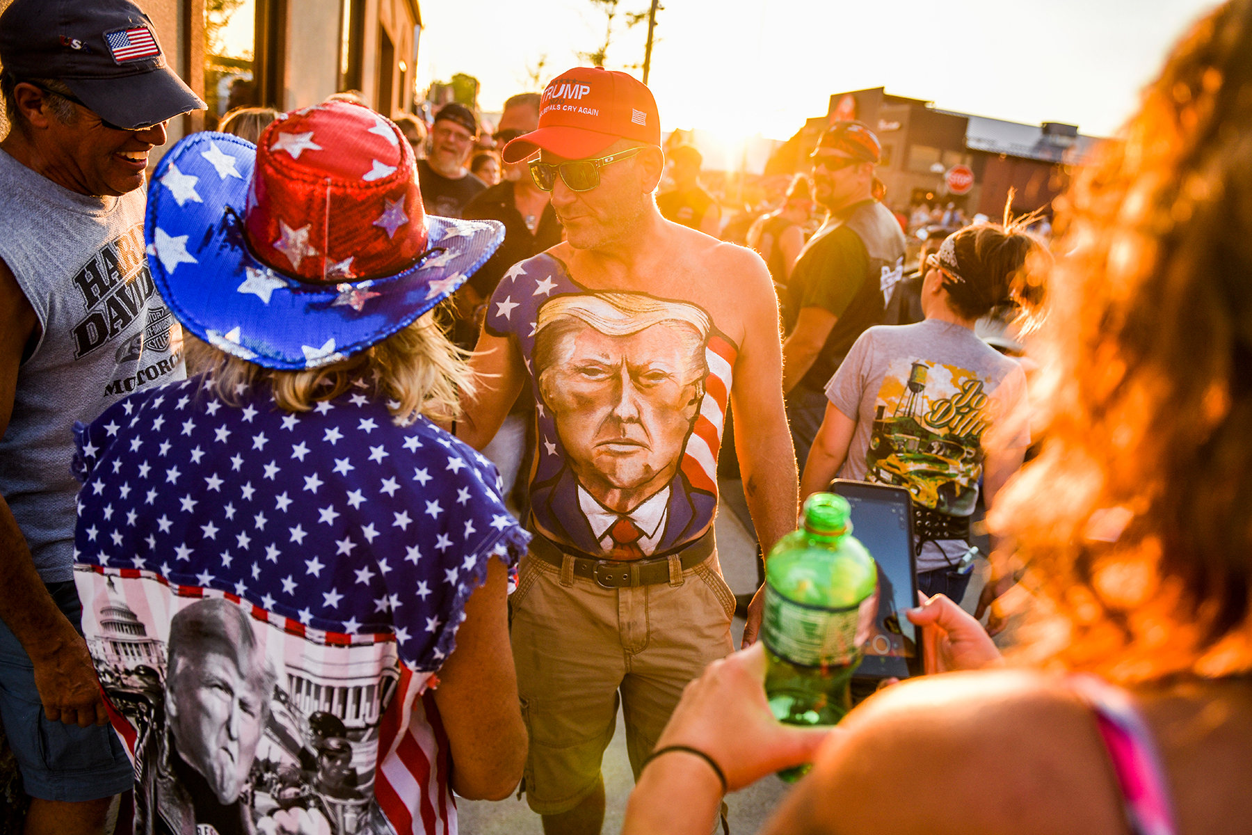 STURGIS, SD - AUGUST 07: Johne Riley walks down Main Street showing off his chest painted with a portrait of President Donald Trump during the 80th Annual Sturgis Motorcycle Rally on August 7, 2020 in Sturgis, South Dakota. While the rally usually attracts around 500,000 people, officials estimate that more than 250,000 people may still show up to this year's festival despite the coronavirus pandemic. (Photo by Michael Ciaglo/Getty Images)