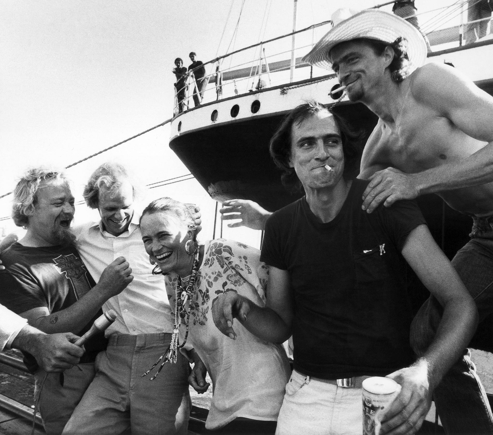 Singer James Taylor, second from right, and members of the Taylor family share a laugh, Aug. 6, 1981 prior to their concert at New York's South Street Seaport Museum to benefit the Museum's Save Our Ships Fund. They are, from left: Alex; Livingston; Kate; James and Hugh Taylor. (AP Photo/Richard Drew)