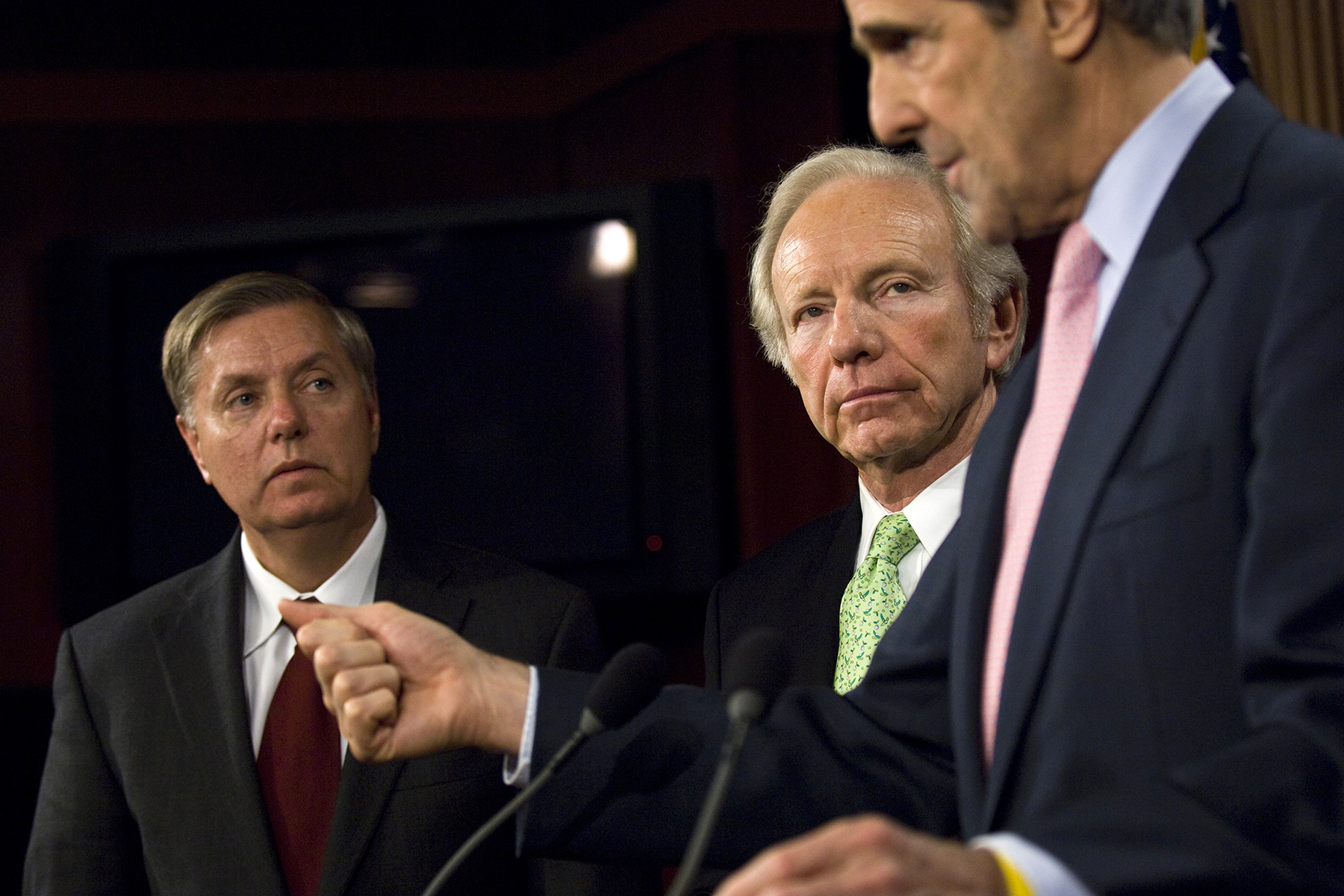 WASHINGTON, DC - DECEMBER 10: Sen. Lindsey Graham, R-S.C., Sen. Joseph I. Lieberman, I-Vt., and Sen. John Kerry, D-Mass., during a news conference on comprehensive climate change and energy independence legislation. (Photo by Scott J. Ferrell/Congressional Quarterly/Getty Images)
