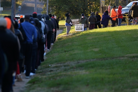 ST LOUIS, MO - NOVEMBER 03: Voters wait on line to cast their ballots on Election Day on November 3, 2020 at Jennings Senior High School in St Louis, Missouri. After a record-breaking early voting turnout, Americans head to the polls on the last day to cast their vote for incumbent U.S. President Donald Trump or Democratic nominee Joe Biden in the 2020 presidential election. (Photo by Michael B. Thomas/Getty Images)