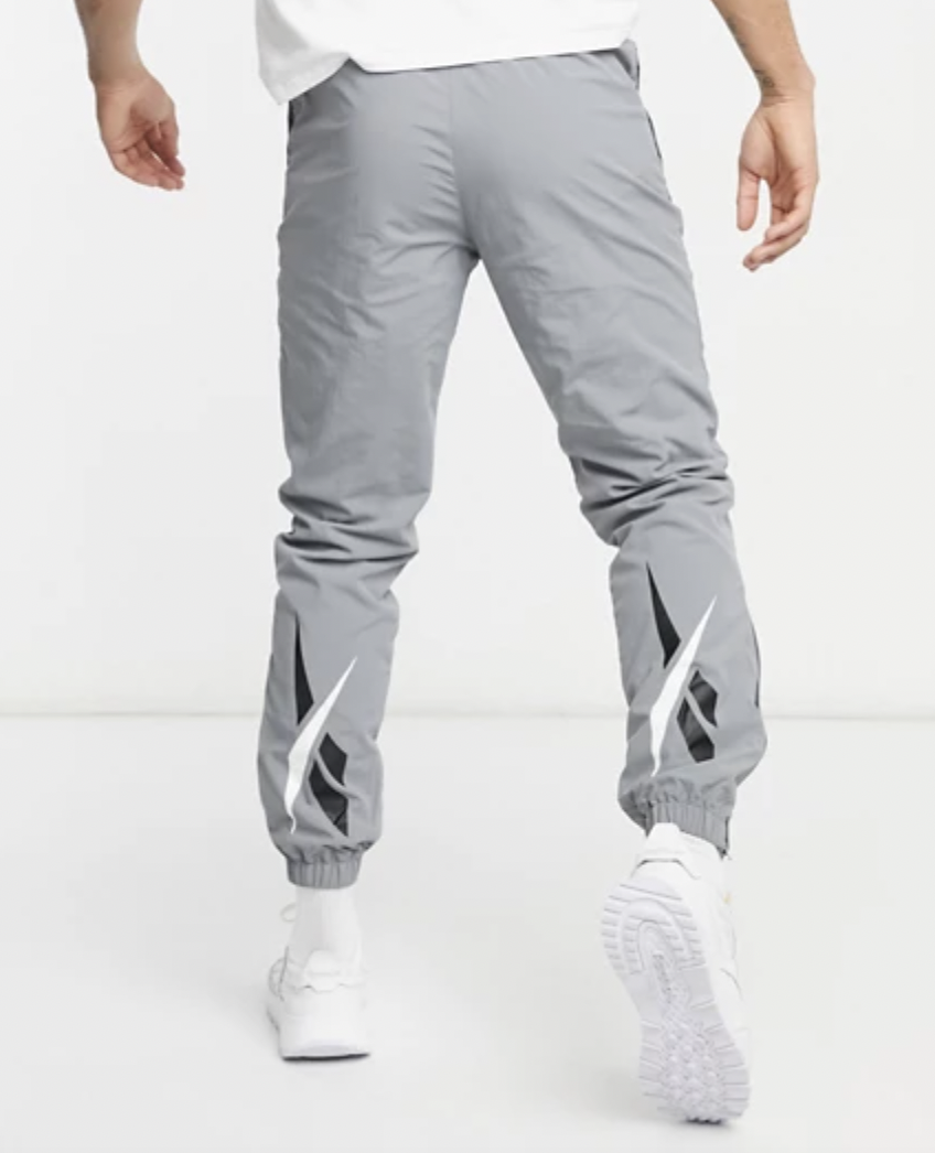 grey track pants reebok