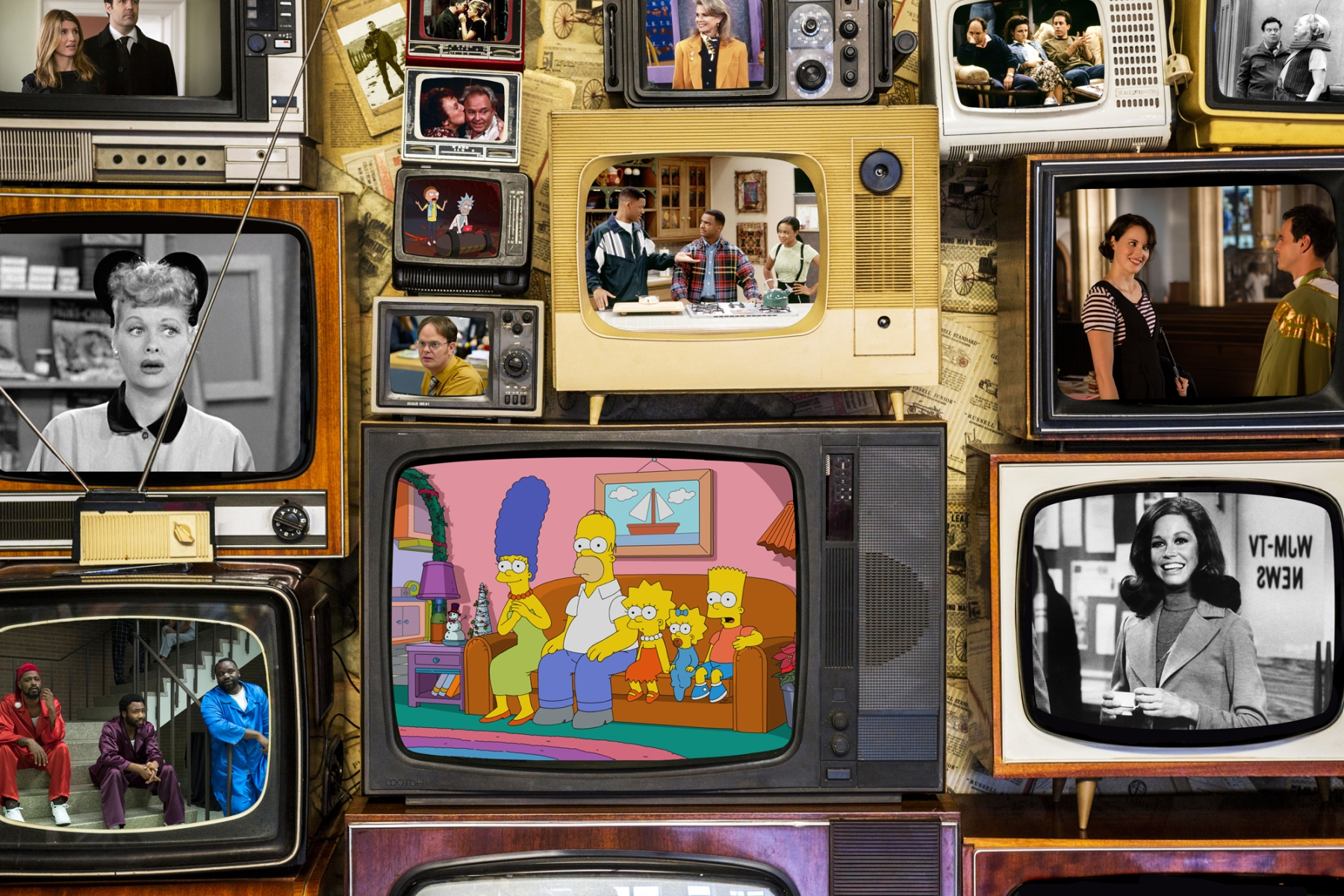 Many old televisions bundled together. A wall of old vintage tube televisions.