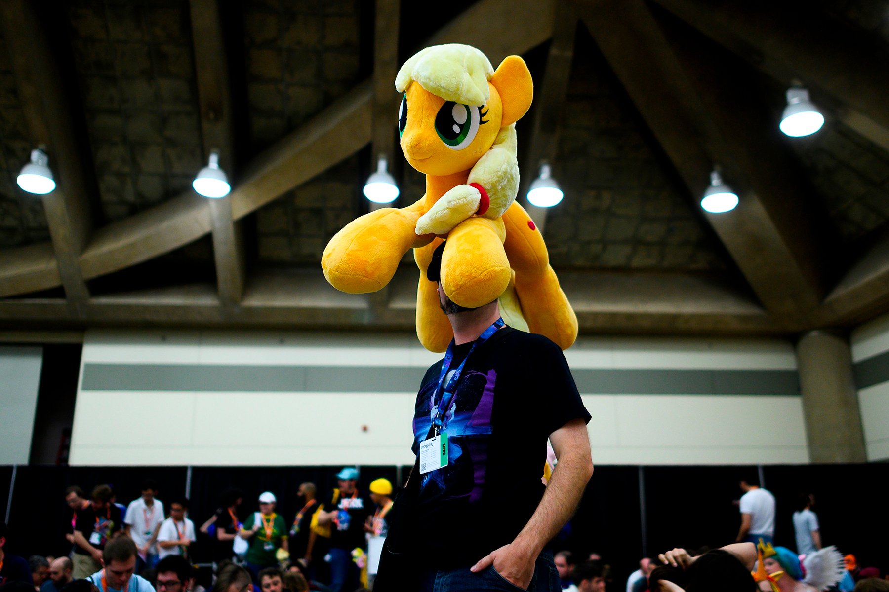 """A man waits in line for the opening ceremony during the BronyCon convention, a gathering for """"My Little Pony"""" fans, at the Baltimore Convention centre in Baltimore, Maryland on August 1, 2019. - BronyCon is an annual fan convention held for fans of """"My Little Pony: Friendship Is Magic,"""" among them adult and teenage fans of the show, who call themselves Bronies. The 2019 convention will be the final BronyCon. (Photo by Andrew CABALLERO-REYNOLDS / AFP)        (Photo credit should read ANDREW CABALLERO-REYNOLDS/AFP via Getty Images)"""
