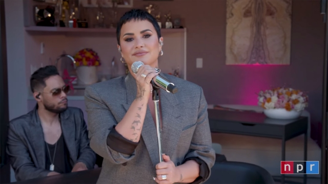 Demi Lovato Performs Stripped-Down Set in Backyard for 'Tiny Desk (Home) Concert'.jpg