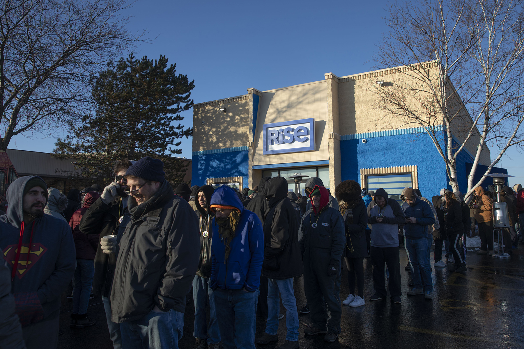 "People wait in line to enter the Green Thumb Industries Rise Mundelein dispensary in Mundelein, Illinois, U.S., on Wednesday, Jan. 1, 2020. Illinois' legalization of recreational pot is likely to be the industry's ""most significant fundamental catalyst"" in 2020 and Cresco Labs Inc. and Green Thumb Industries Inc. will benefit the most, according to investment firm Compass Point. Photographer: Daniel Acker/Bloomberg via Getty Images"