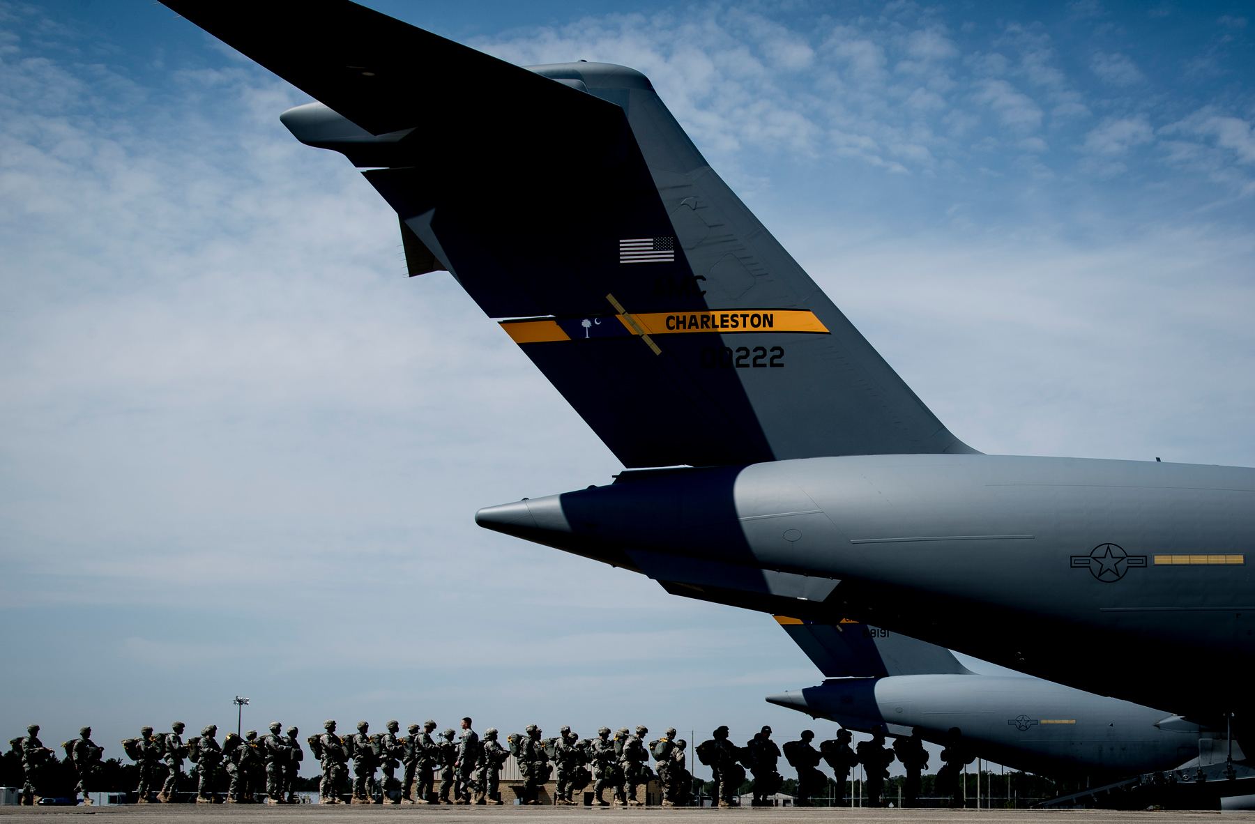 U.S. Soldiers assigned to the 82nd Airborne Division file into an Air Force C-17 Globemaster III aircraft March 27, 2014, at Ft. Bragg, N.C., during exercise Raging Moose. The large-formation exercise was designed to meet more than 500 operational and training objectives and included airdrops, aerial refueling operations and aerial formations. (DoD photo by Airman 1st Class Clayton Cupit, U.S. Air Force /Released)