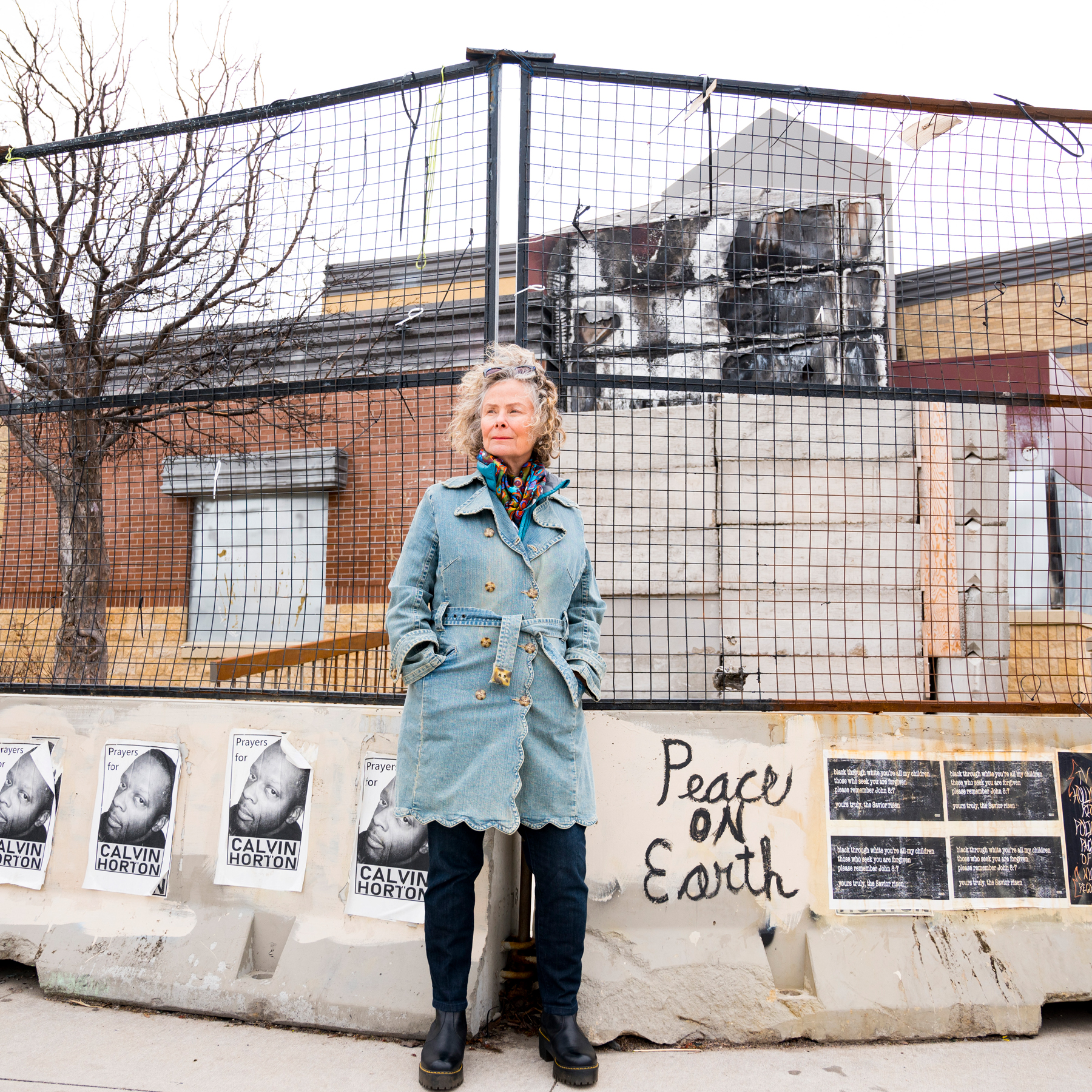 Anita Muldoon photographed in front of what once was the 3rd Precinct in South Minneapolis. Th building is now abandoned.
