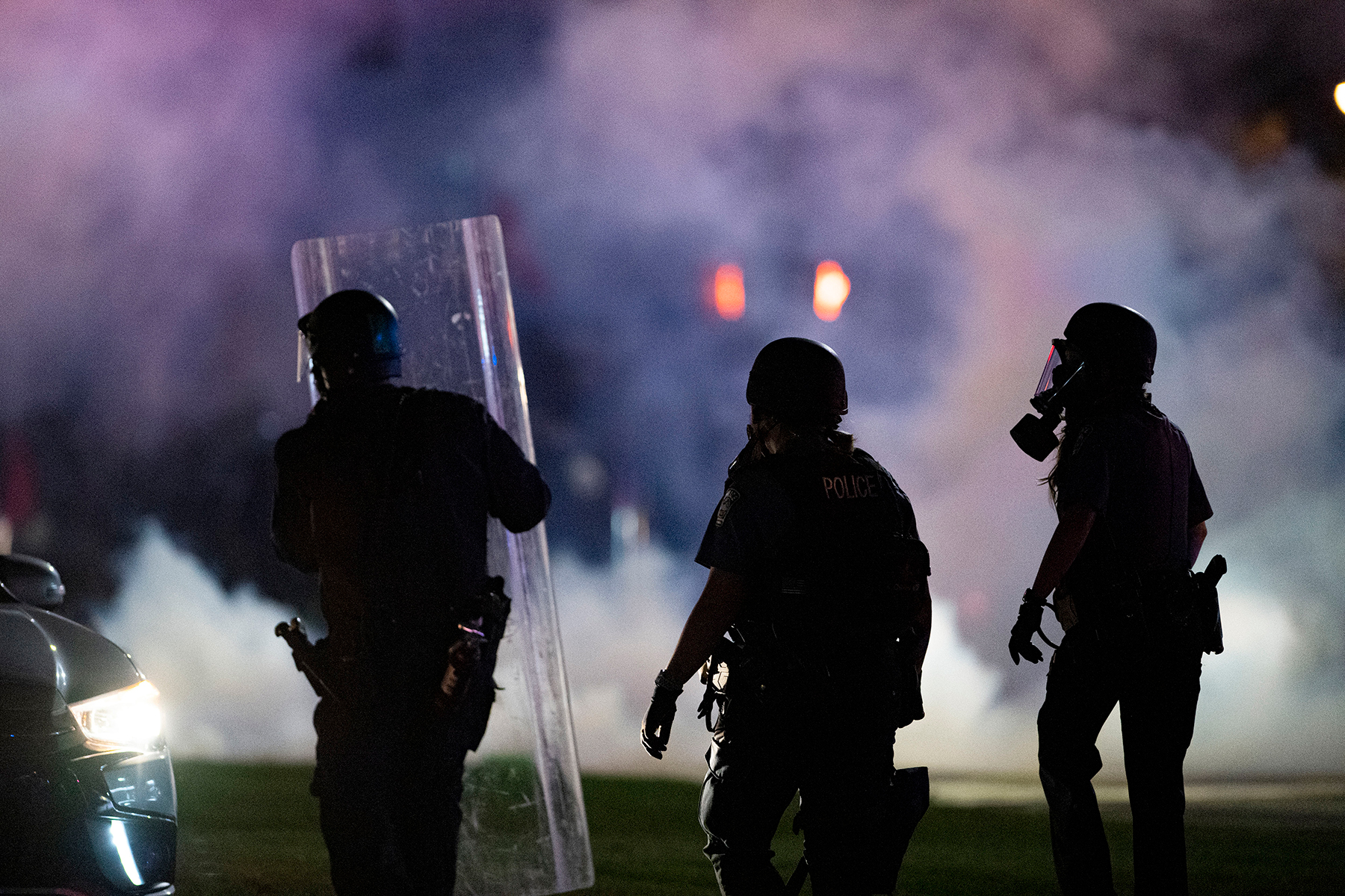 Police march through the tear gas toward the crowd of protesters blocking Nevada Avenue Saturday night, May 30, 2020, in Colorado Springs, Colo. Protests have been erupting all over the country after George Floyd died on Memorial Day in police custody in Minneapolis. (Christian Murdock/The Gazette via AP)