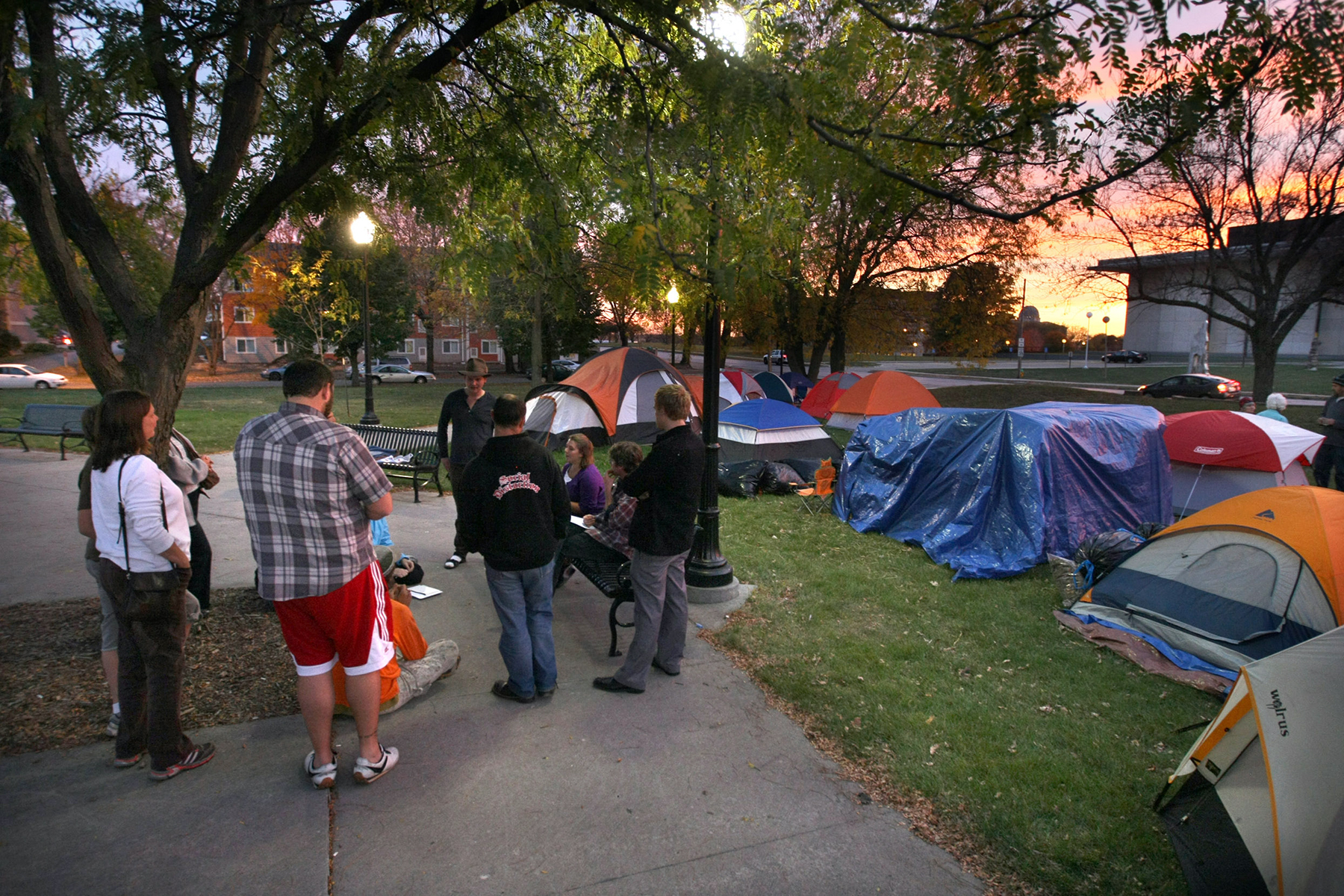 Small groups gather at the Occupy Des Moines encampment at Stewart Square east of the capitol on Thursday, Oct. 20, 2011 in Des Moines. Protesters from across the country will be invited to help occupy all the presidential campaign headquarters in Iowa. Under a plan approved at Occupy Iowa's meeting Monday, Oct. 31, 2011, in Des Moines, the protesters would go in the headquarters to share their message. If they aren't let in, the protesters would try to shut down the headquarters by sitting in front of their doors. Occupy Iowa is an offshoot of the Occupy Wall Street movement. (AP Photo/The Des Moines Register, Bill Neibergall) MANDATORY CREDIT