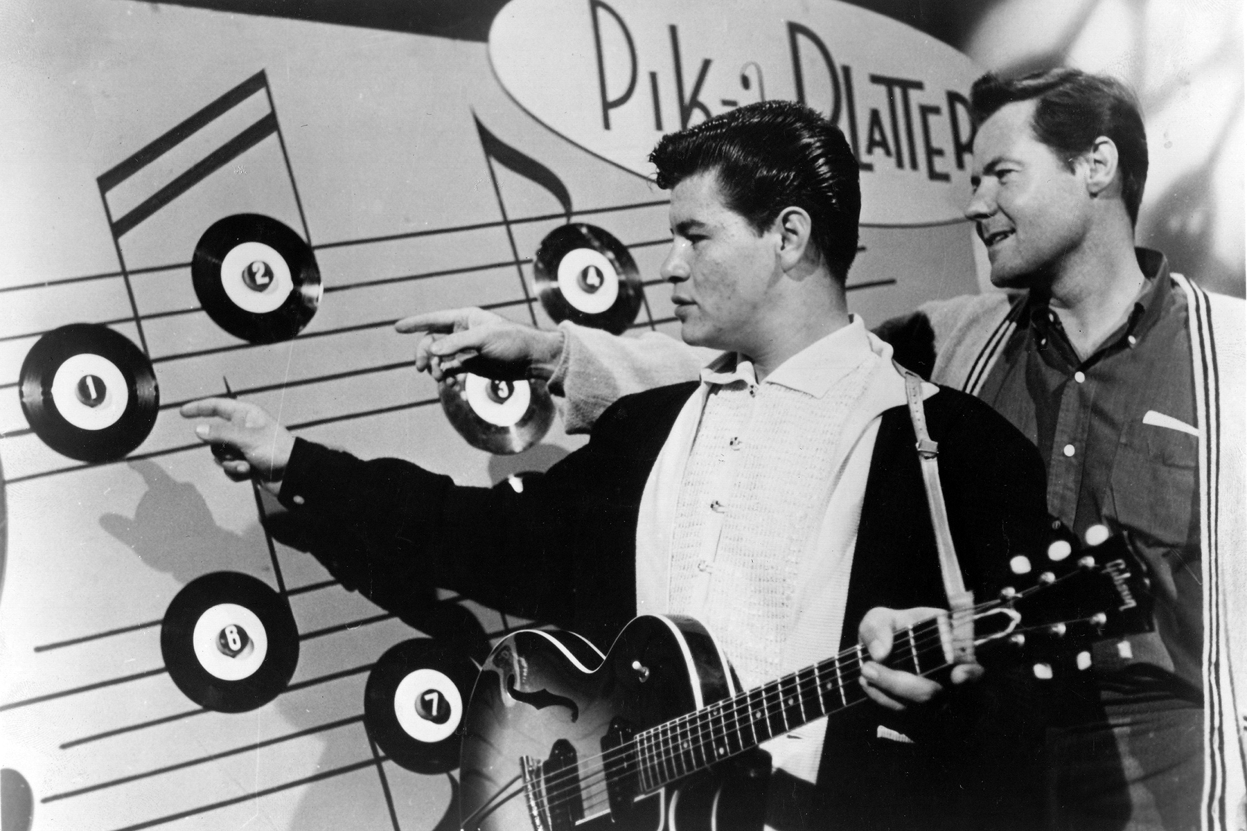 Ritchie Valens poses with Bob Keane (Presdient of Del-Fi Records) in 1958 in the United States. (Photo by Gilles Petard/Redferns)