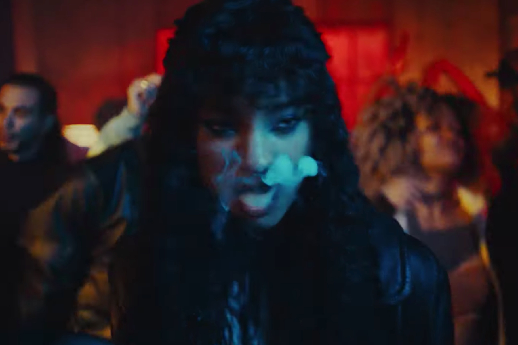 Willow Smith Confronts a Terrifying Figure in a Dingy Rock Club in 'Transparent Soul' Video