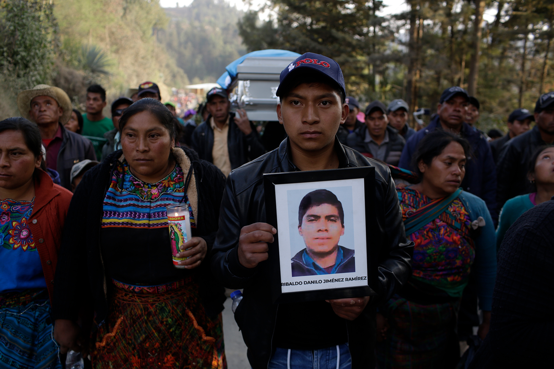 TUILELÉN, COMITANCILLO, GUATEMALA - MARCH 14: Angel Mauricio cousin of Rivaldo Danilo Jimenez holding his picture on March 14, 2021 in Comitancillo, Guatemala. 19 shot and charred bodies were found in two trucks on January 22, 2019 along the Mexican-American border town of Camargo in Tamaulipas. 16 of them were undocumented Guatemalan migrants seeking to reach the United States. 12 Mexican police officers of the elite GOPE group remain detained, accused of murder, abuse of authority and filing fraudulent reports. (Photo by Josue Decavele /Getty Images)