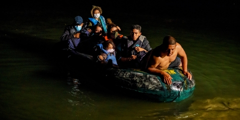 Cartel coyotes ferry migrants across the Rio Grande Riva at Roma, Texas, April 22, 2021. You can tell the boats are in the water on the Mexico side of the river when you hear the babies and children start to cry as they cross the river. Most of the refugees this night came from Central America and paid 800 per person to travel the several hundred yards across the river to the American side. When they get to the American side they head up a hill and are met by the US Border Patrol, and there they are processed and taken to facilities. Coyotes rowing migrants across the river.