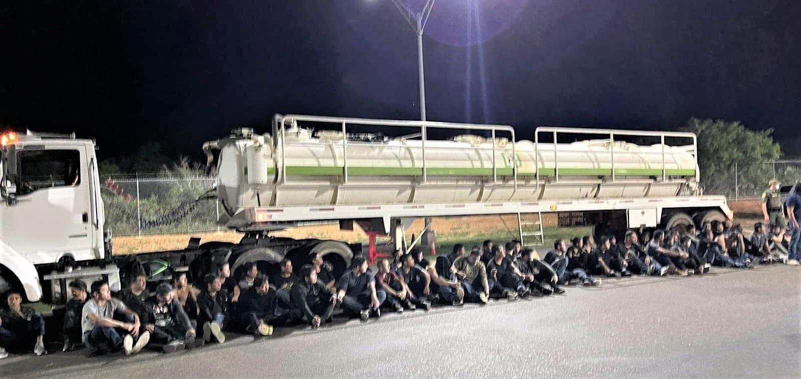 Border agents find nearly 50 people hidden inside a tanker trailer near Laredo.