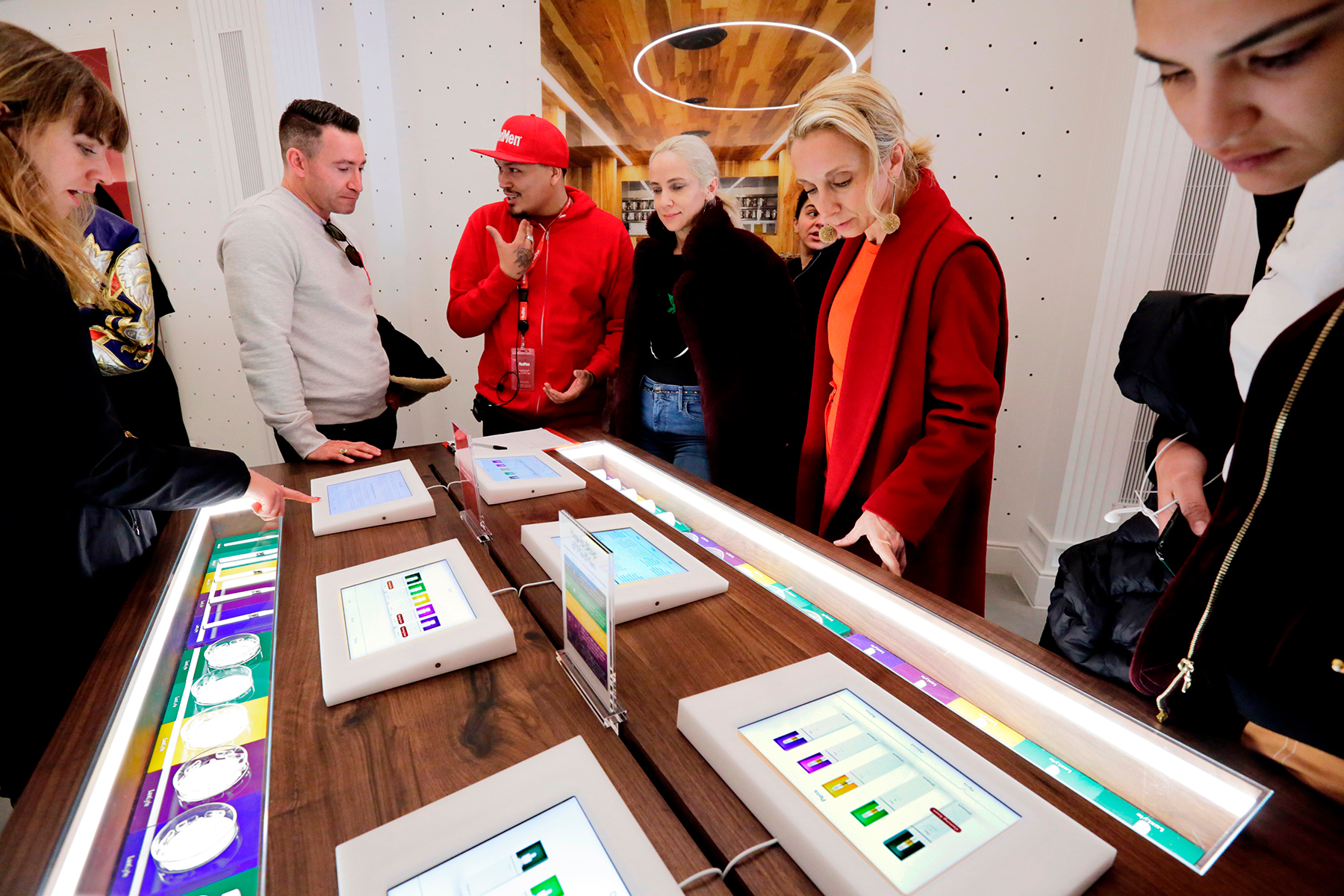 Customers of MedMen listen to an employees describe products in the new store on New York's Fifth Avenue, Friday, April 20, 2018. MedMen owns and operates licensed cannabis facilities in cultivation, manufacturing and retail.(AP Photo/Richard Drew)