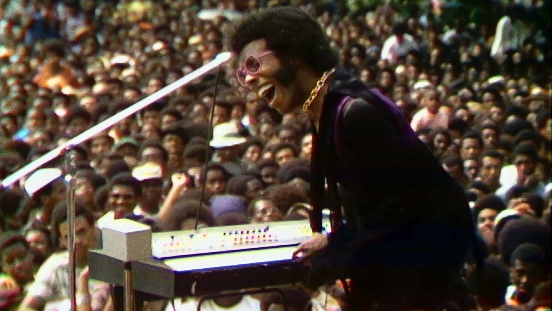 Sly Stone performing at the Harlem Cultural Festival in 1969, featured in the documentary SUMMER OF SOUL. Photo Courtesy of Searchlight Pictures. © 2021 20th Century Studios All Rights Reserved