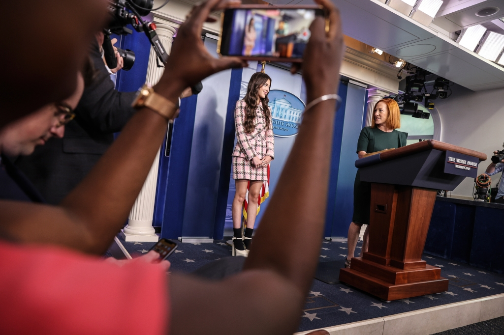 Jen Psaki, White House press secretary, introduces Olivia Rodrigo, during a news conference in the James S. Brady Press Briefing Room with Jen Psaki, White House press secretary, at the White House in Washington, D.C., U.S., on Wednesday, July 14, 2021. Photographer: Oliver Contreras/Pool/Sipa USA(Sipa via AP Images)