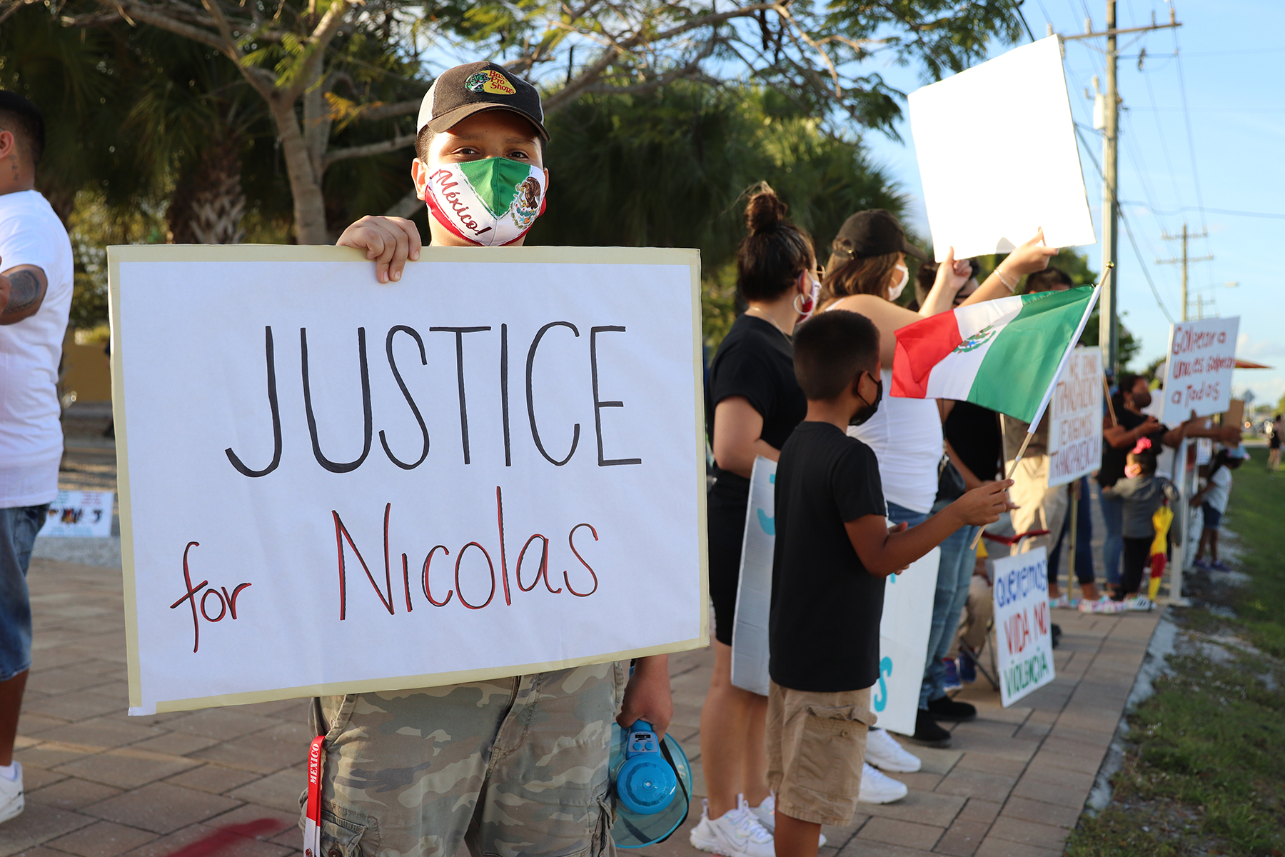 A friend of Nicolas Jr. at a vigil at the zocalo in Immokalee, Florida, February 2021.
