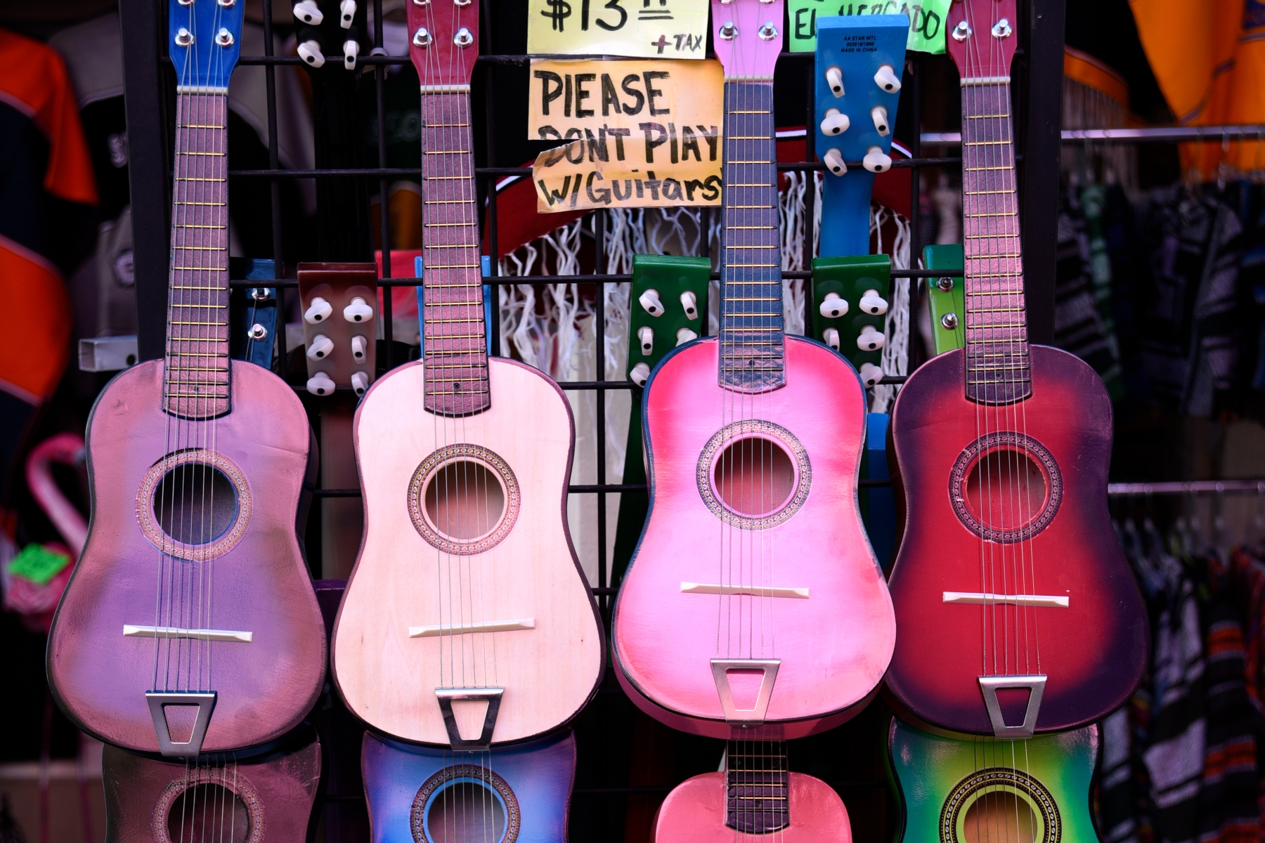 SAN ANTONIO, TEXAS - DECEMBER 9, 2018:  Colorful children's guitars are among items for sale at a shop in the Historic Market Square, also known as El Mercado, in San Antonio, Texas. (Photo by Robert Alexander/Getty Images)
