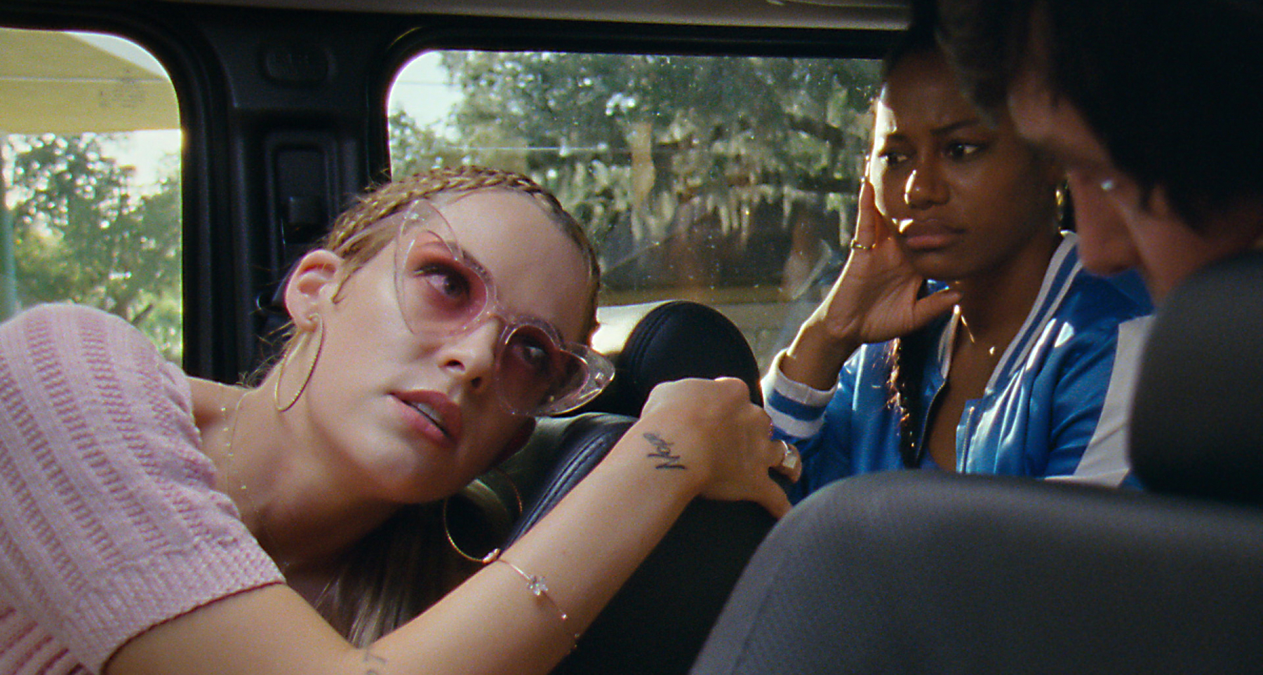 """Riley Keough (left) stars as """"Stefani"""" and Taylour Paige (right) stars as """"Zola"""" in director Janicza Bravo's ZOLA, an A24 Films release. Cr. A24 Films"""