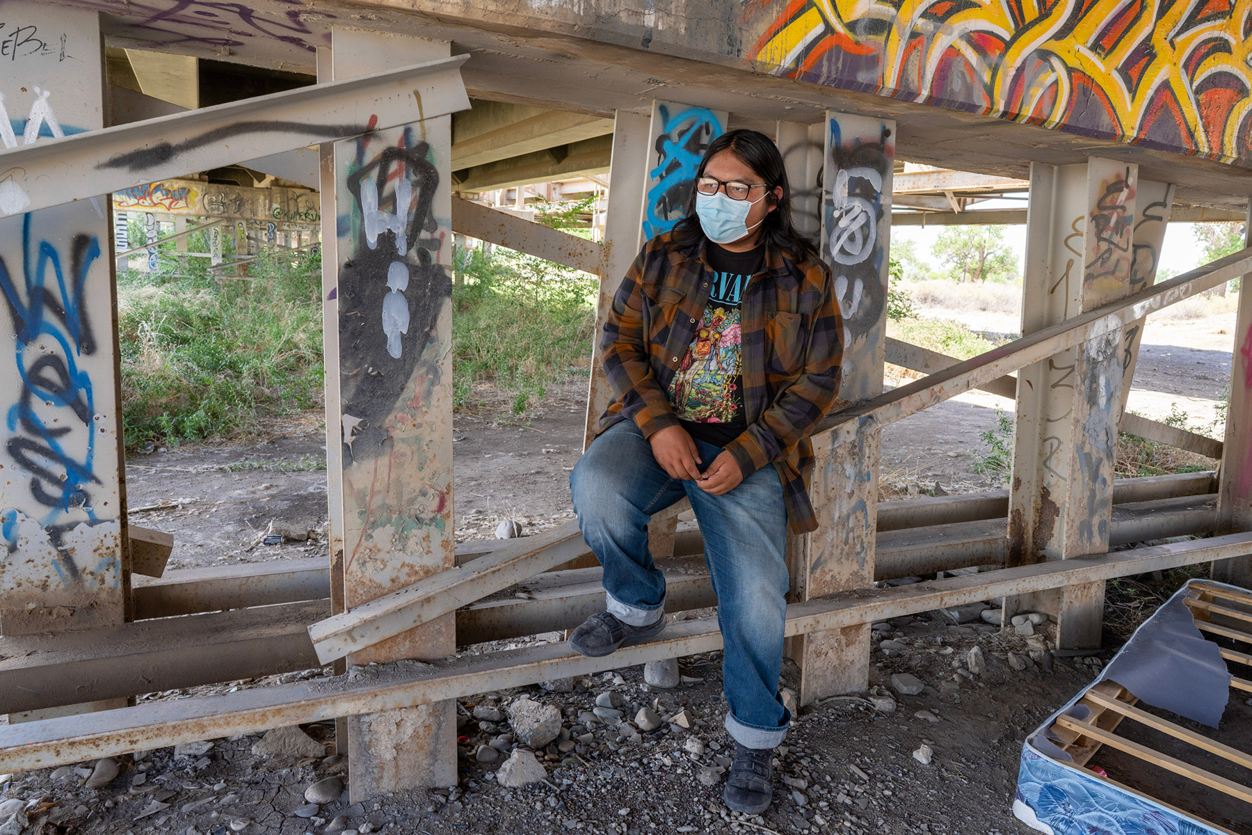 Navajo high school student Evan Allen, shown here beneath the U.S. Highway 64 bridge in Shiprock, attended school all year sitting in a truck on a remote hill — the only place he could get a decent internet connection.