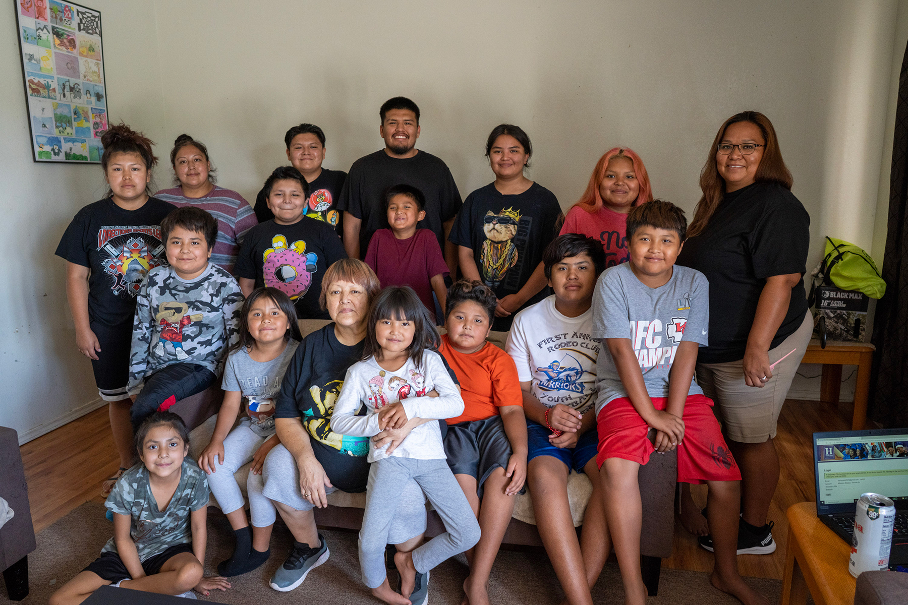 The extended Mariano family (Tammie on right) poses for a photo in their home in Shiprock. Internet access was a struggle for every age group.
