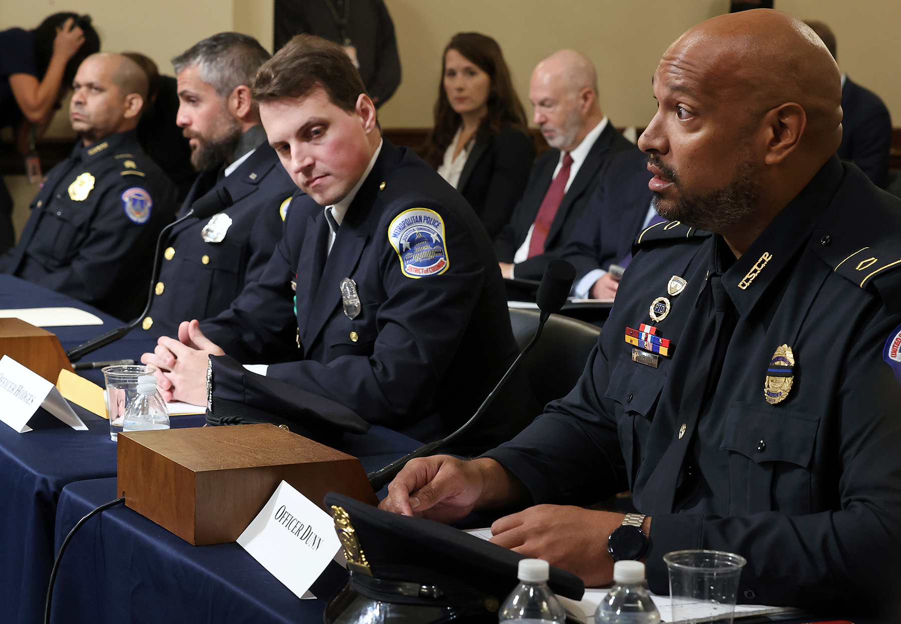 U.S. Capitol Police Sgt. Aquilino Gonell, from left, Washington Metropolitan Police Department officer Michael Fanone, Washington Metropolitan Police Department officer Daniel Hodges and U.S. Capitol Police Sgt. Harry Dunn testify before the House select committee hearing on the Jan. 6 attack on Capitol Hill in Washington, Tuesday, July 27, 2021. (Chip Somodevilla/Pool via AP)