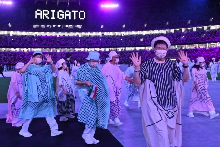 Performers wave to the crowd during the closing ceremony of the Tokyo 2020 Olympic Games, at the Olympic Stadium, in Tokyo, on August 8, 2021. (Photo by Adek BERRY / AFP) (Photo by ADEK BERRY/AFP via Getty Images)