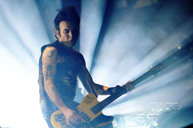 The Cure Bassist Simon Gallup Says He's Back in Band.jpg